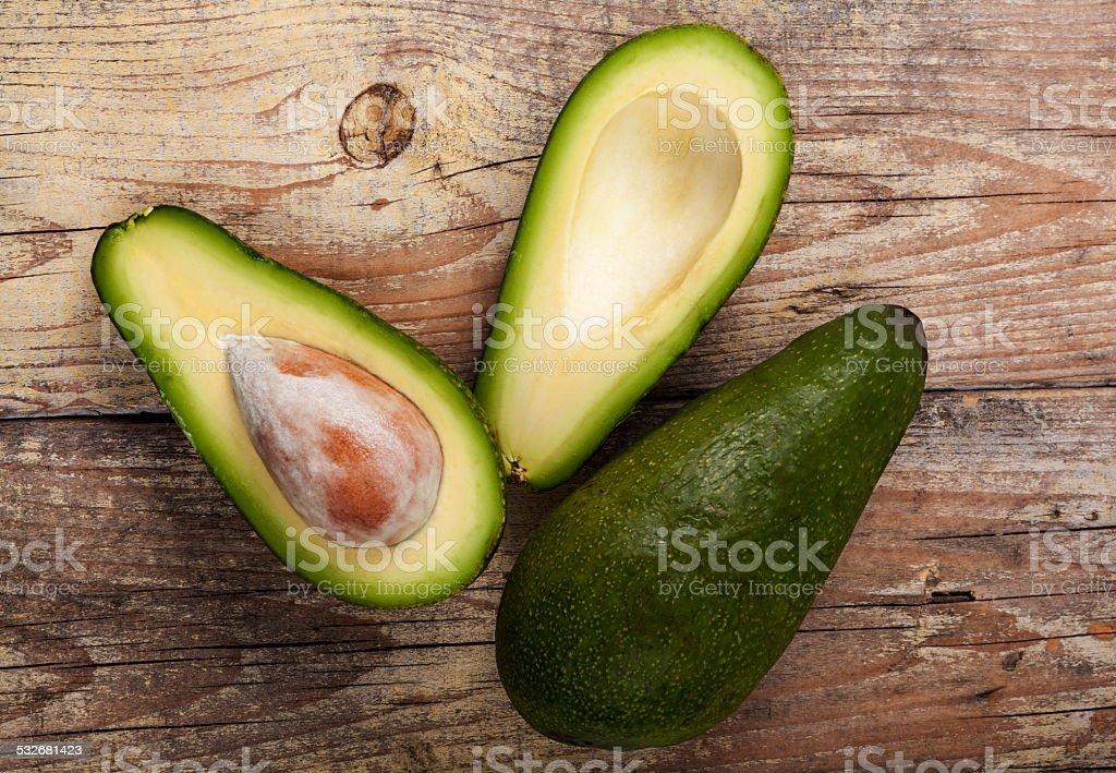 Green Avocado on Wood stock photo
