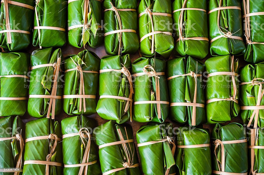 Green background of Khao Tom Mad, dessert food of Thailand stock photo