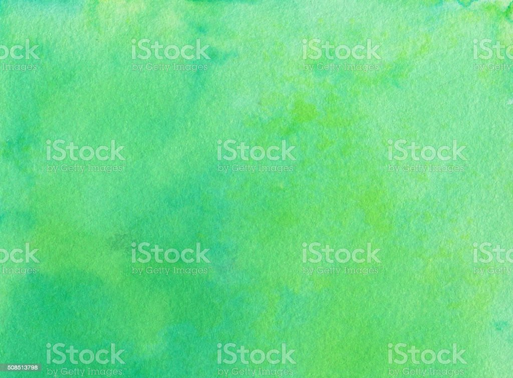 Green background with subtle texture hand painted on paper stock photo