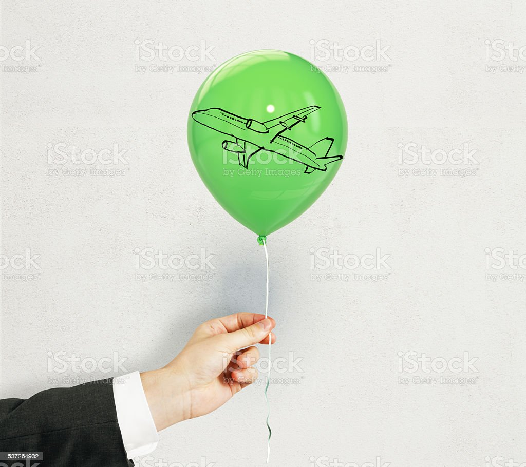 Green balloon with plane stock photo