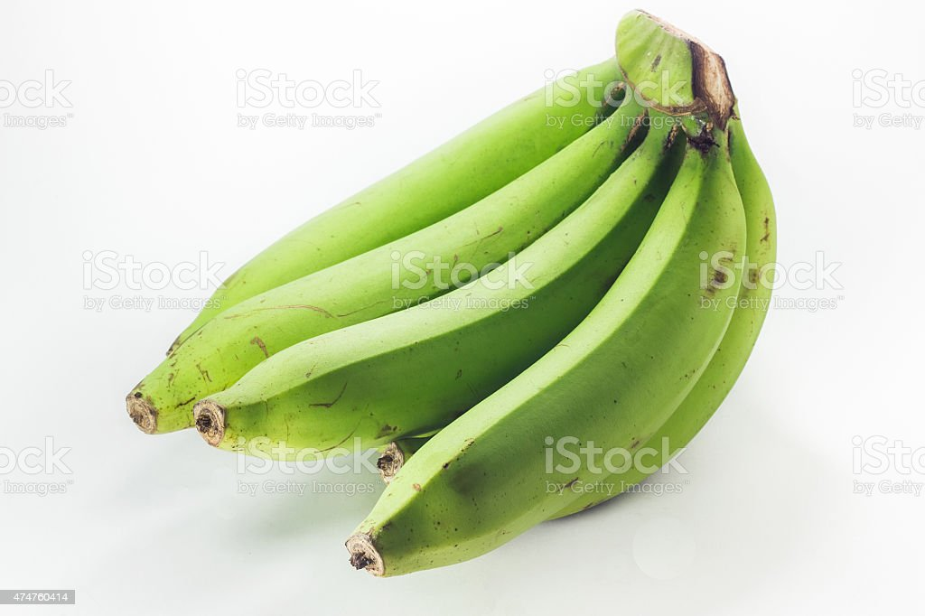 green bananas isolated on white background stock photo