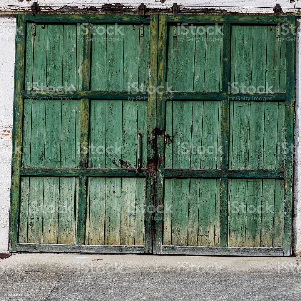 Green barn door stock photo