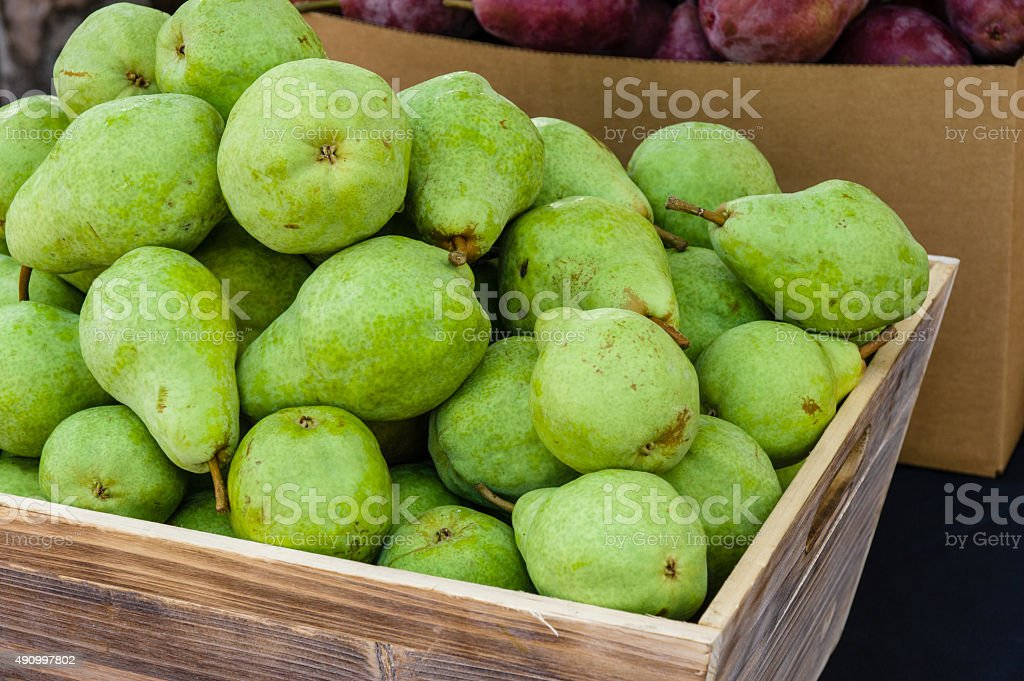 Green bartlett pears for sale at market stock photo