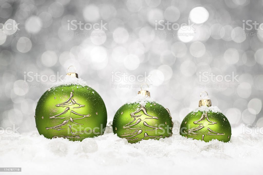 Green Baubles Lying on Snow royalty-free stock photo