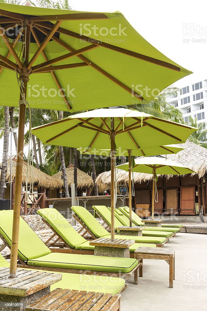 Green beach chair on side pool royalty-free stock photo