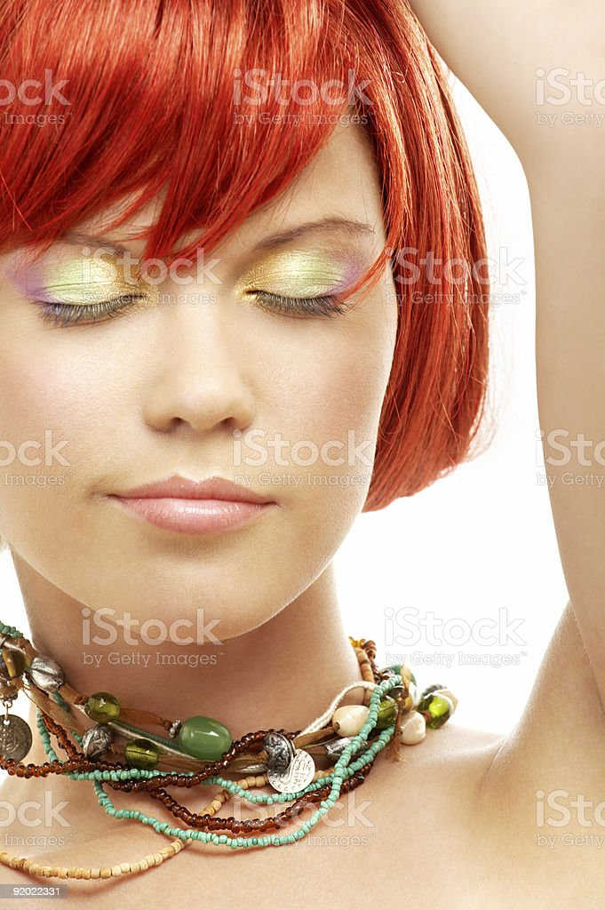 green beads redhead with eyes closed royalty-free stock photo