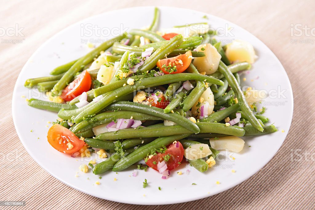 green bean salad with tomato and egg stock photo