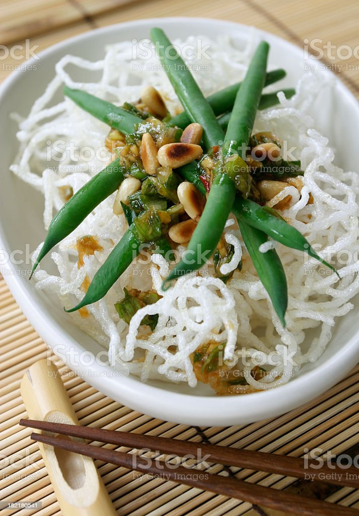 Green beans and crispy noodles. royalty-free stock photo