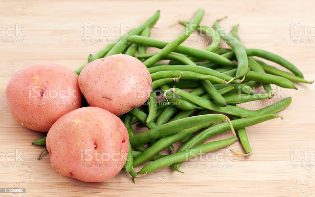 Green Beans and Potatoes on a Wooden Background stock photo