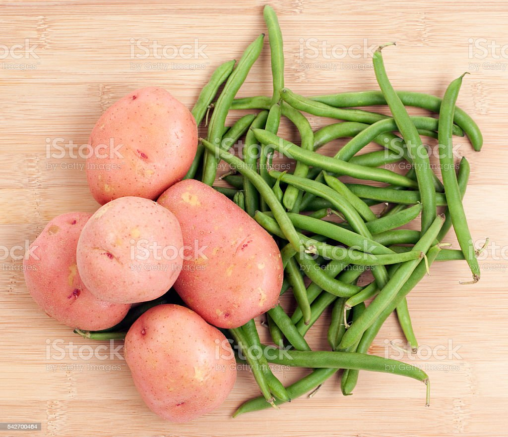 Green Beans and Potatoes on Wood Background stock photo