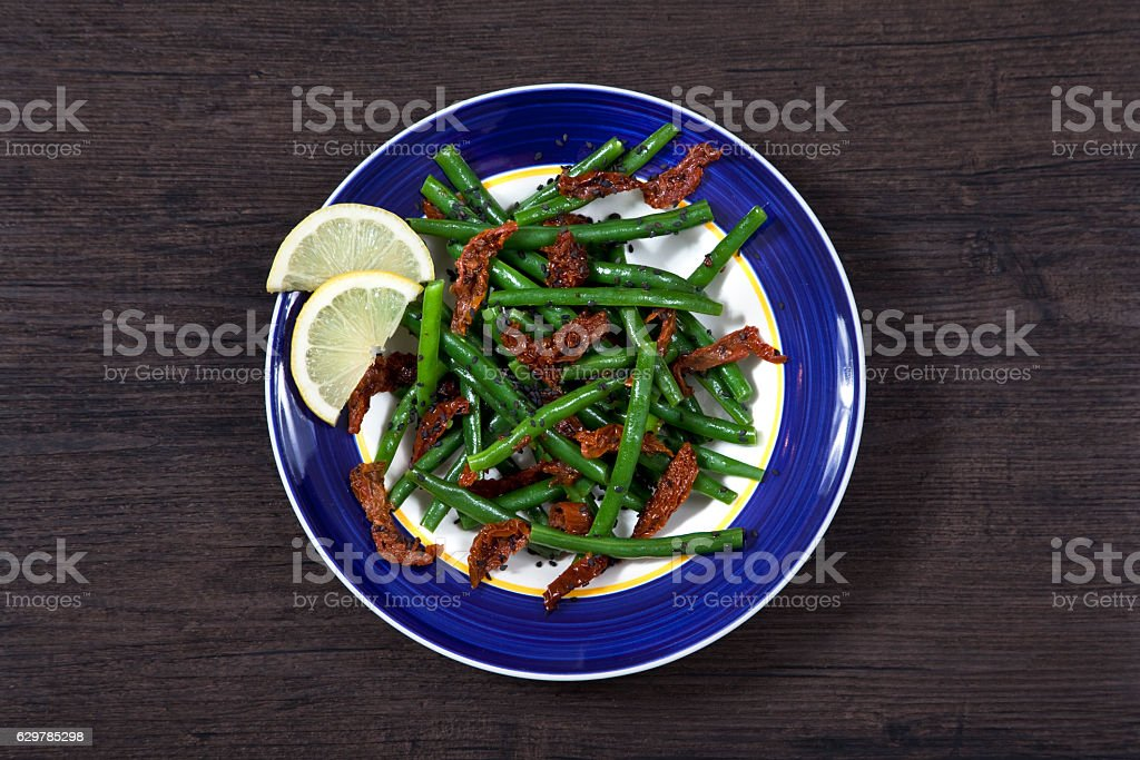 Green beans and sun dried tomato salad stock photo
