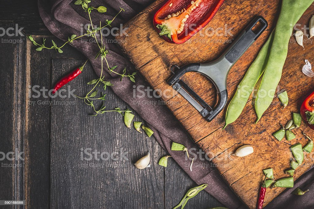 Green  beans cooking preparation with vegetables peeler stock photo