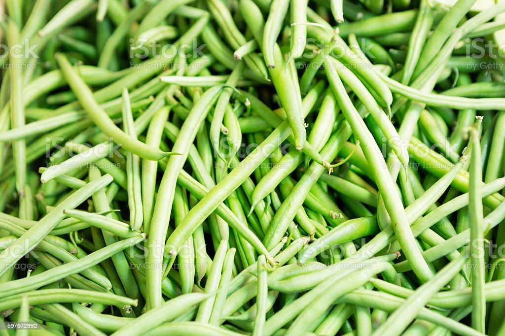 Green beans on market stall stock photo