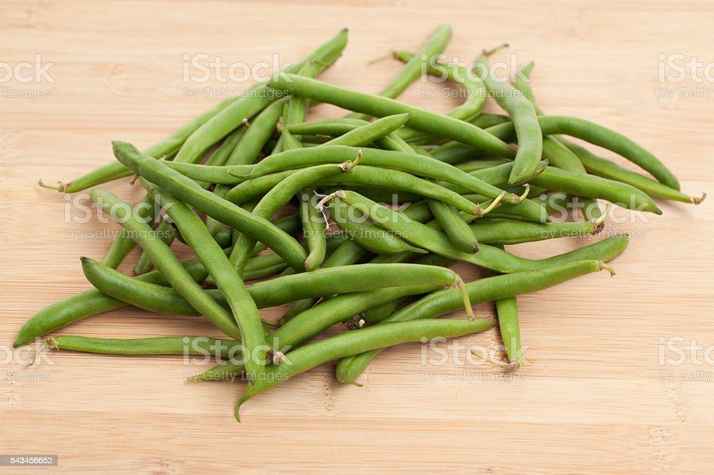 Green Beans on Wood Backgound stock photo