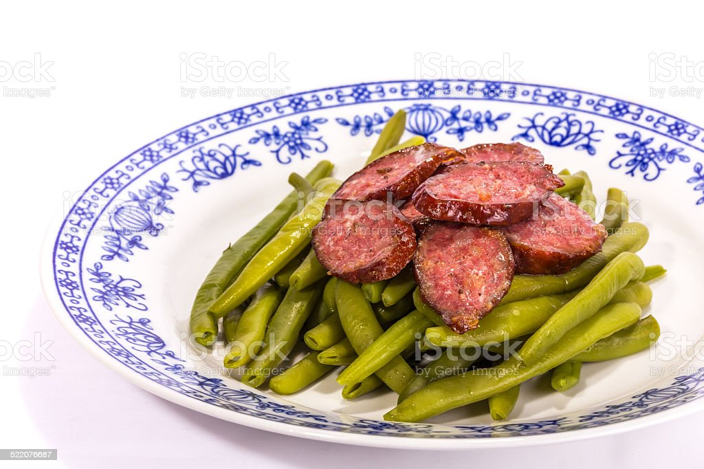 Green beans with German sausages stock photo