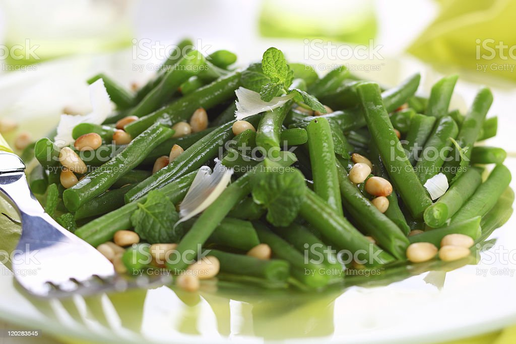 green beans with parmesan and pine nuts stock photo