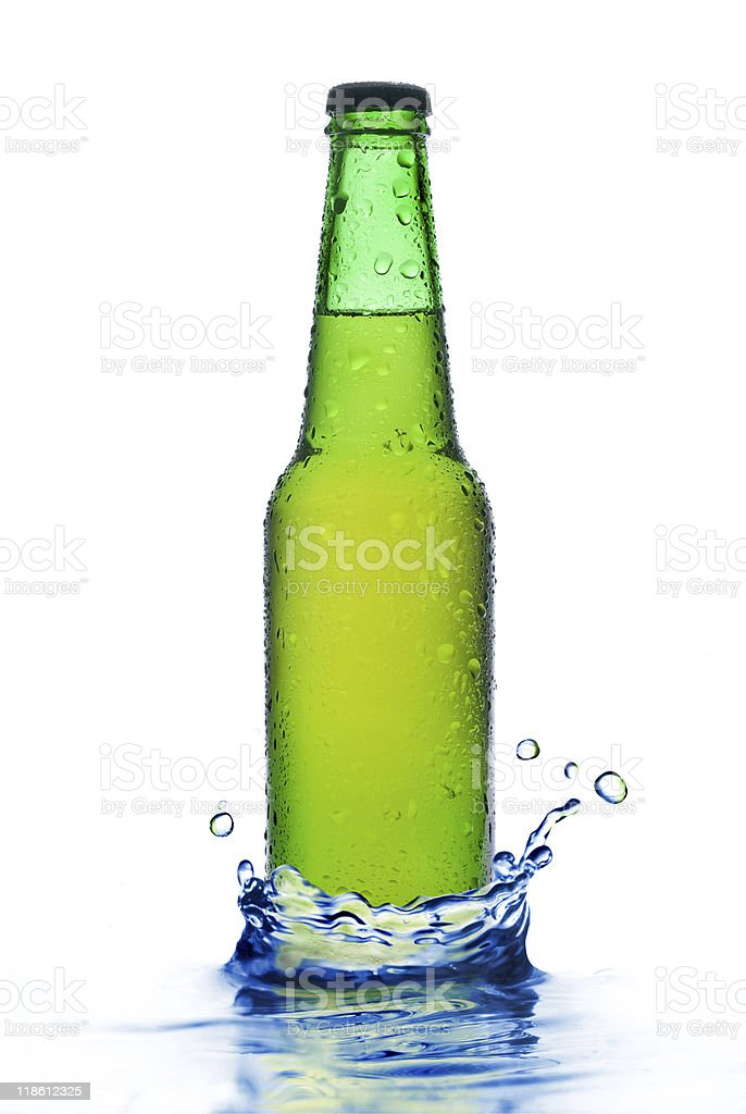 Green beer bottle with water splash royalty-free stock photo