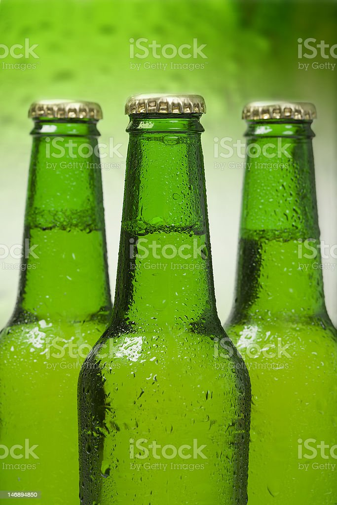 Green beer bottles with silver caps royalty-free stock photo