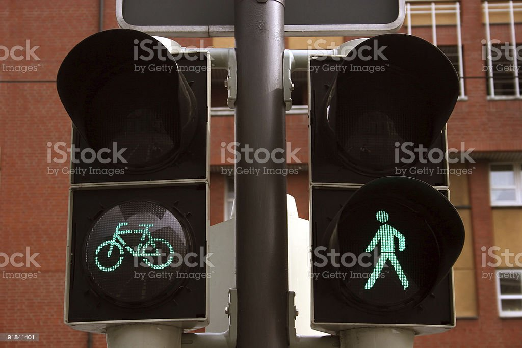 Green bicycle and pedestrian traffic lights stock photo