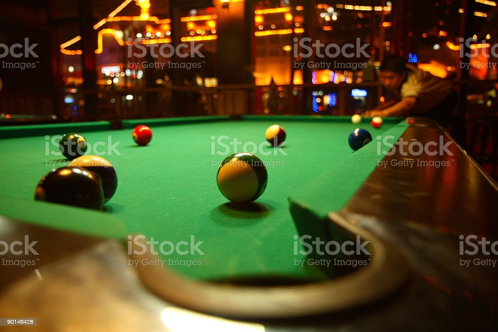 Green billiards table with pool balls royalty-free stock photo