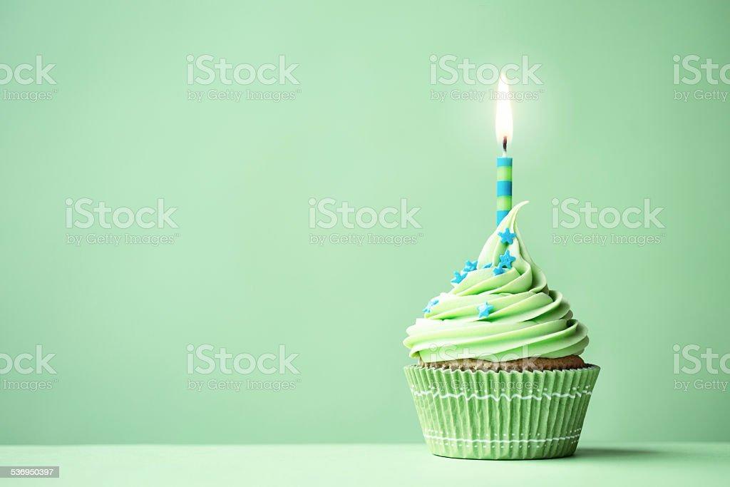 Green birthday cupcake stock photo