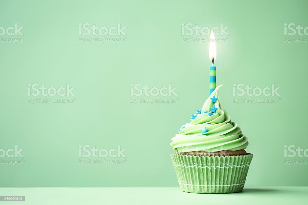 Green birthday cupcake stock photo