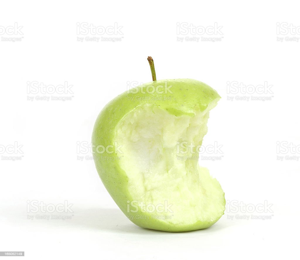 Green bitten apple isolated on white royalty-free stock photo