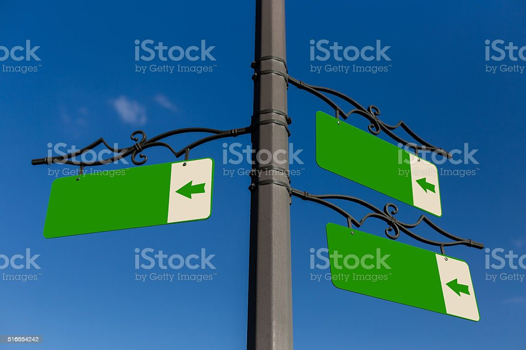 Green blank signpost stock photo