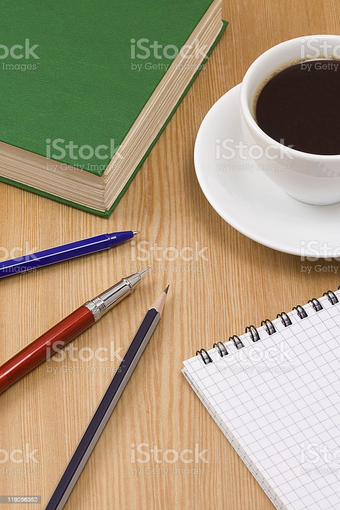 green book and cup stock photo