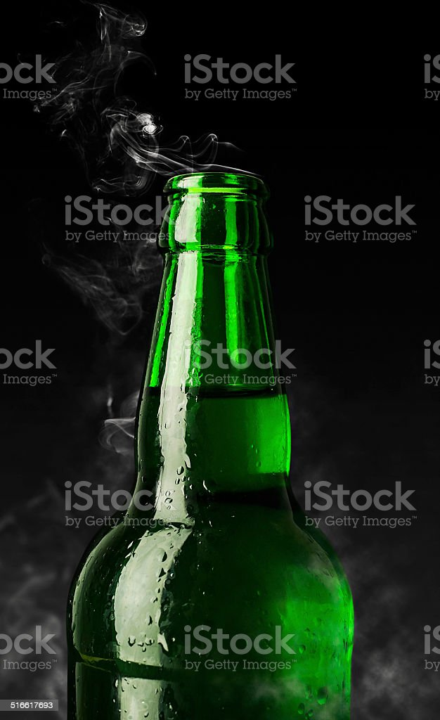 green bottle of chilled beer stock photo