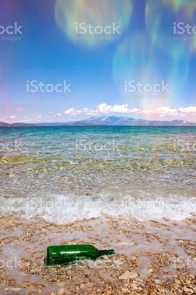 green bottle on the seaside stock photo