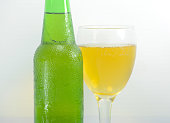 Green Bottle with and Glass of beer  on white