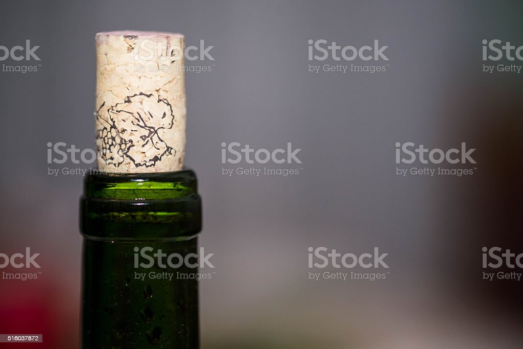 green bottle with cork, blurred background stock photo
