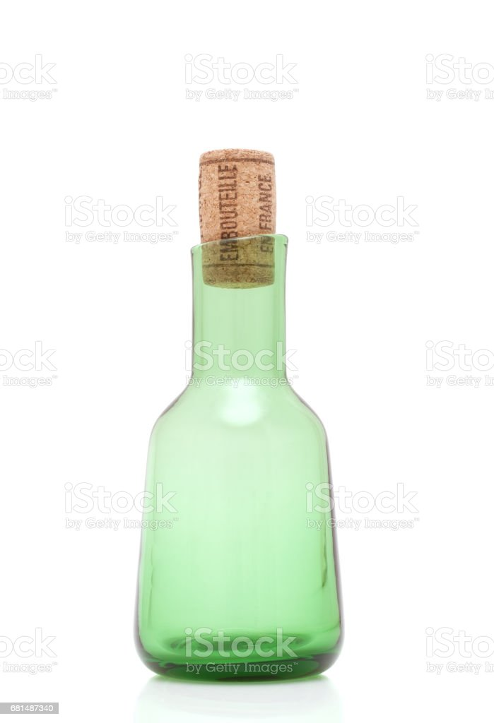 Green bottle with cork isolated on white stock photo