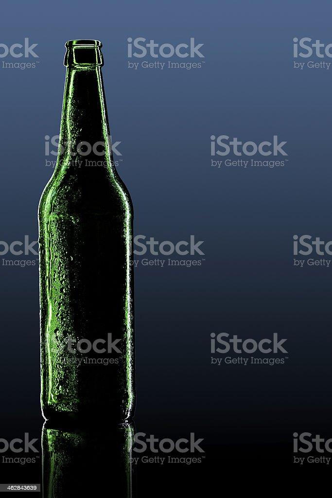 green bottle with dark background stock photo