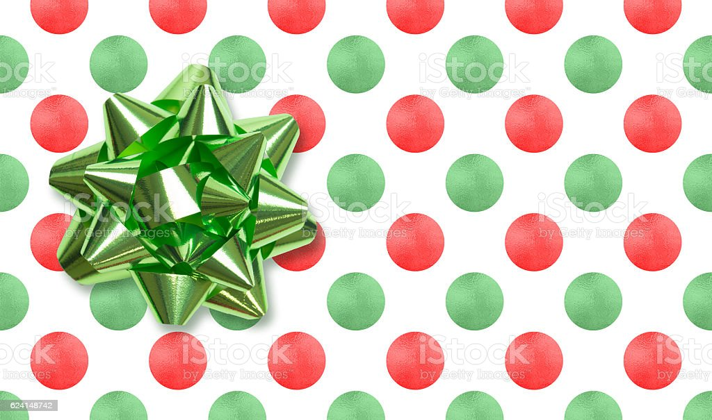 Green bow on Christmas dot background stock photo
