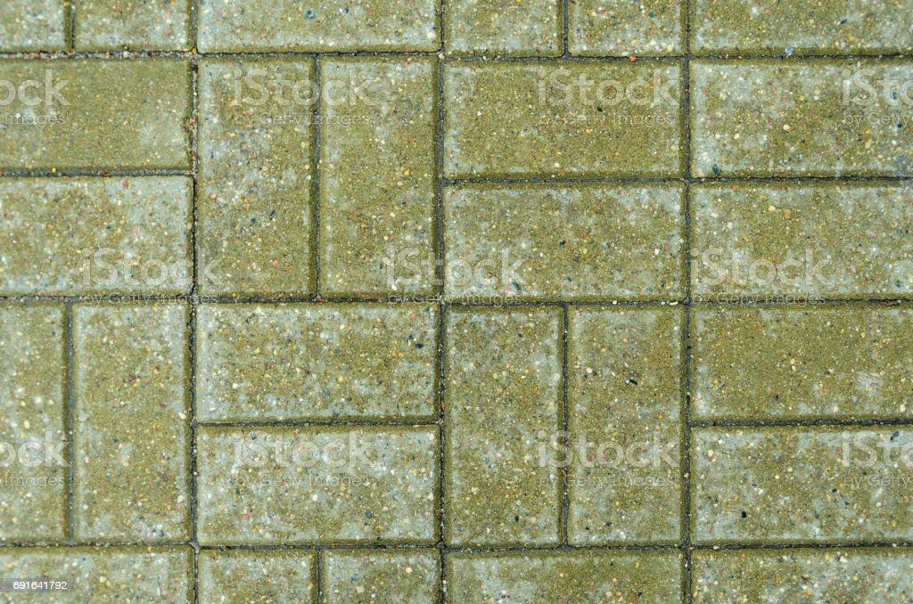 Green brick paving stones on a sidewalk stock photo