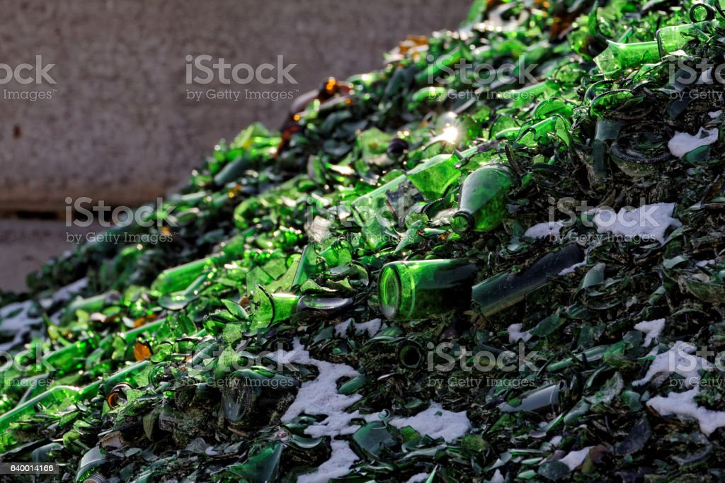 green broken empty bottles for recycling - recovery of waste stock photo