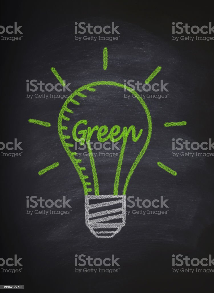 Green bulb on blackboard stock photo