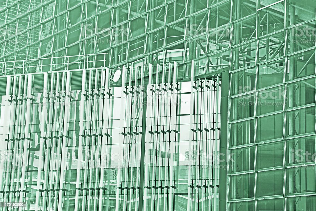 Green business concept: modern glass and steel facade royalty-free stock photo