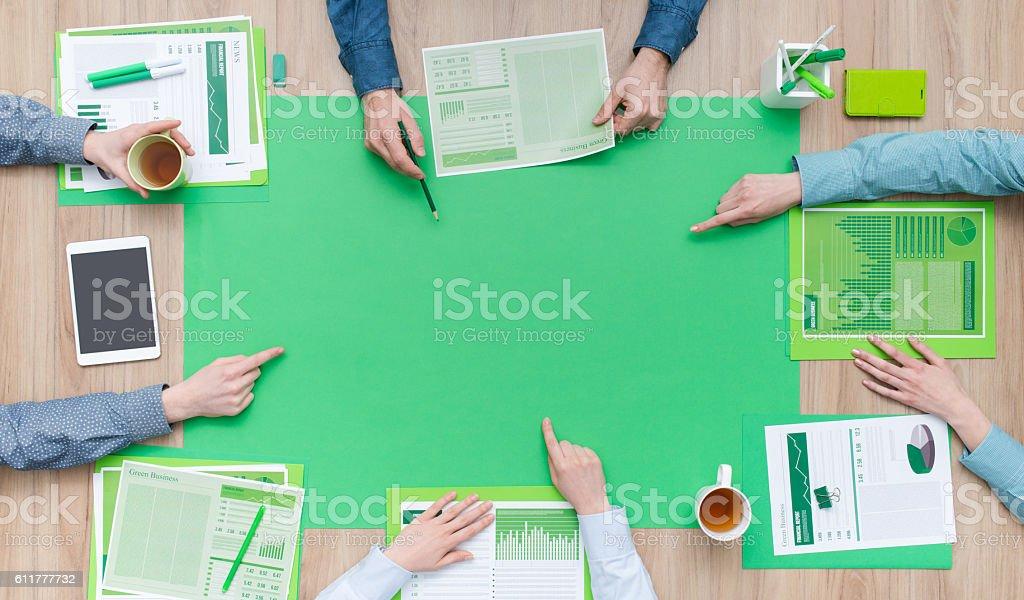 Green business team stock photo
