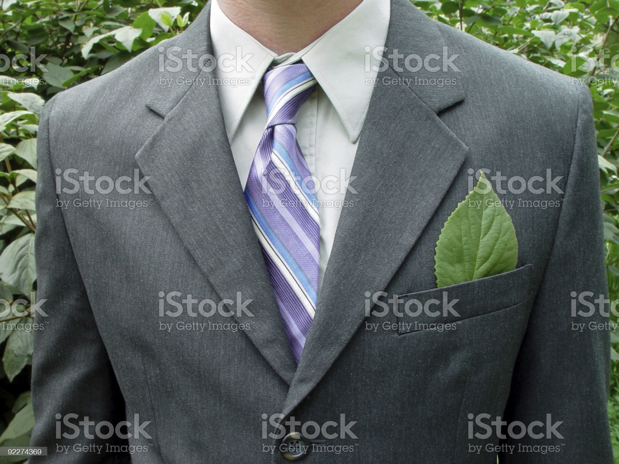 Green businessman with leaf in pocket, see more below. royalty-free stock photo