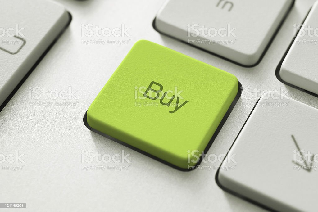 A green buy key on a computer keyboard royalty-free stock photo