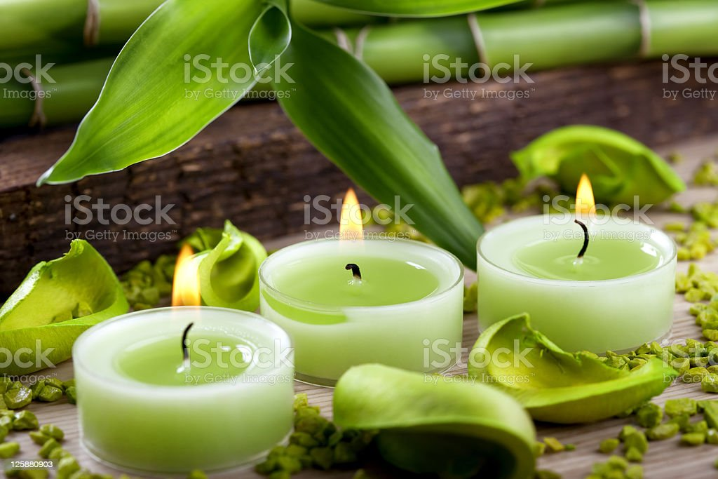 Green candles and bamboo decoration stock photo