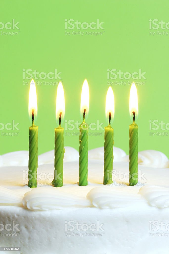 Green candles on a cake stock photo