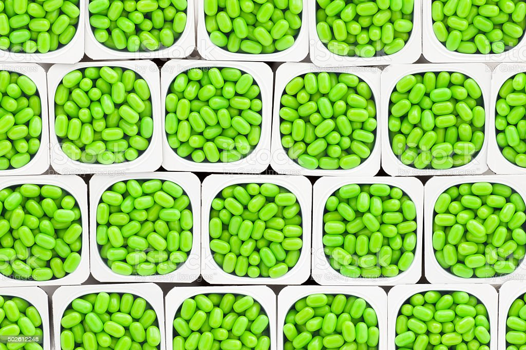 Green candy pills stock photo