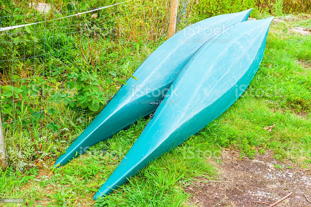 Green canoes stock photo