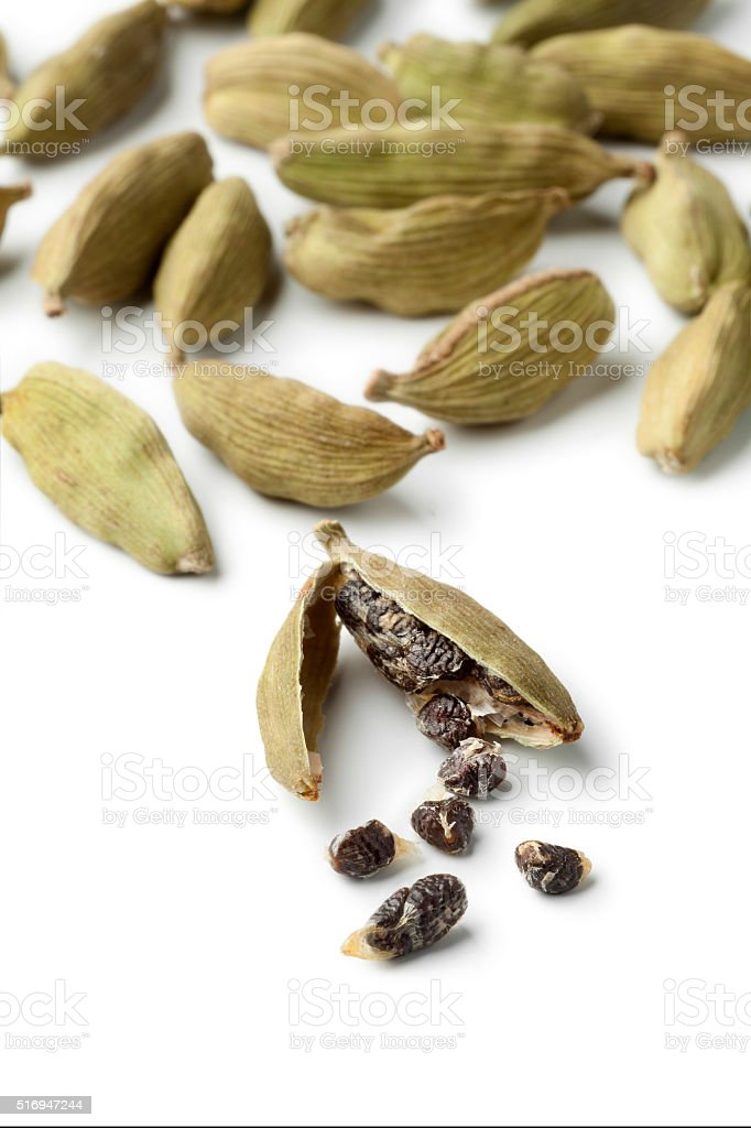 Green cardamom pods and seeds close up stock photo