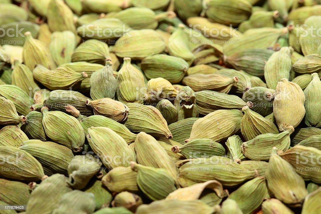 Green cardamom seeds. Aromatic spice.texture background royalty-free stock photo