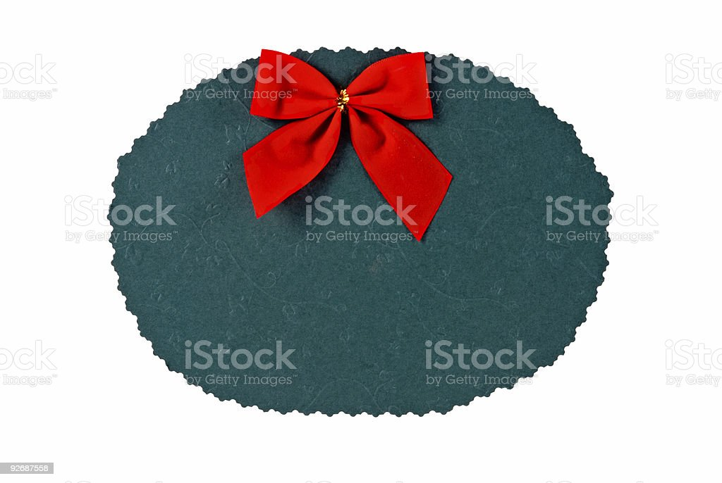 green cardboard paper with scalloped edge and a red bow royalty-free stock photo